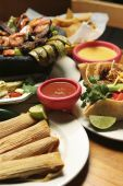 picture of mexican food  - Vertical shot of a variety of Mexican dishes - JPG