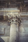 Stonework, Corinthian capitals, stone columns in old building in Spain