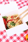 image of chinese checkers  - Chinese noodles and sticks in takeaway box on fabric background - JPG