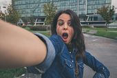 Pretty Girl Taking A Selfie In The City Streets