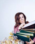 Mad faced teacher with folders in hands