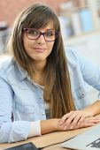 Portrait of student girl wearing eyeglasses in class