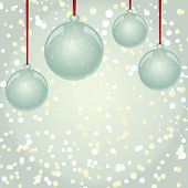 Christmas balls with ribbon hanging on snowflakes background