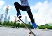 picture of skateboarding  - young woman skateboarder skateboarding at modern city - JPG