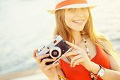 Young attractive girl with camera