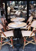 Colorful tables and chairs in sidewalk cafe Paris, France