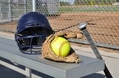 Yellow Softball, Helmet, Bat, And Glove