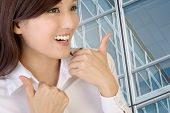 Happy smiling businesswoman with gesture.