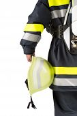 Firefighter holding helmet isolated on white