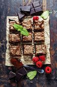 homemade brownie pieces on the board, food closeup