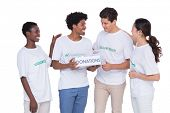 Young smiling volunteers collecting donations on white background