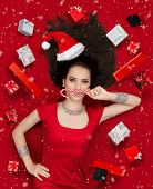 Funny Christmas Girl with Candy Cane surrounded by Presents