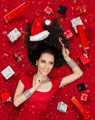 pic of lollipops  - Beautiful smiling woman in sweet Christmas fantasy portrait with lollipop and gifts - JPG