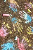 kids hands prints on pavement