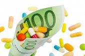 tablets and one hundred euro banknote symbolic photo costs for medicine and drugs the pharmaceutical industry