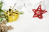 Gold Christmas Gifts With Silver Ribbon And Needles Fir With Red