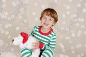 Winter Holidays: Laughing Happy Child In Christmas Pajamas Sled In Snow