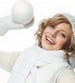 attractive young caucasian woman in warm clothing  studio shot isolated on white smiling winter rose flower with snow ball