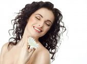 closeup portrait of attractive  caucasian smiling woman brunette isolated on white studio shot lips toothy smile face hair head and shoulders eyes closed tooth flower