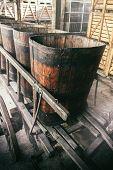 Old Wooden Wheelbarrow With Vats