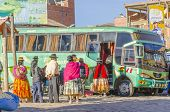 COPACABANA, BOLIVIA, MAY 6, 2014: Local people in traditional costumes get on the bus
