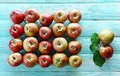 Juicy apples on wooden background