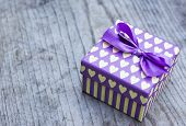 Purple Gift Box With Yellow Hearts Greeting Card