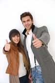 Trendy couple showing thumbs up, isolated