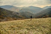Woman Walking In Autumn Mountains