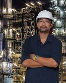 stock photo of refinery  - Asian worker with oil refinery plant and pipe line - JPG