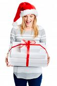Christmas gift sale and merry young lady with santa hat and smile