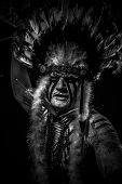 traditional Native, American Indian chief with big feather headdress