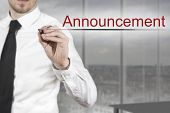 Businessman Writing Announcement In The Air