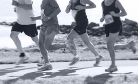 image of claddagh  - Group of runners compete in the race on coastal road - JPG