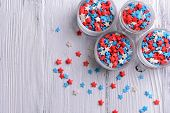 image of sprinkling  - Colorful sprinkles in bowls on table close - JPG