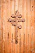 image of crucifixion  - Wooden cross with silver detail representations of the Crucifixion on green background - JPG