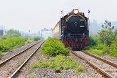 picture of locomotive  - thailand locomotive trains running on rialroad track use for vintage land transportation topic  - JPG