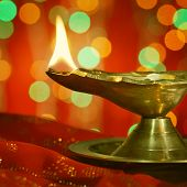 picture of diwali lamp  - A metallic traditional Indian lamp illuminated in dark - JPG