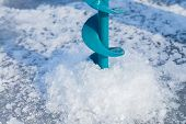 image of ice fishing  - Close-up drill for ice fishing. Winter fishing on the river. Sport, Fishing, river, drill ice fishing. ** Note: Soft Focus at 100%, best at smaller sizes - JPG