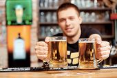 pic of bartender  - Freshly tapped beer - JPG