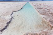 stock photo of salt mines  - Ojo del Mar in a salt desert in the Jujuy Province - JPG