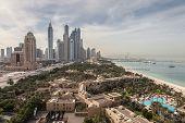 image of dubai  - Dubai Marina Skyscrapers and Arabian Gulf Coast in Dubai United Arab Emirates  - JPG