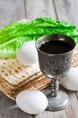stock photo of passover  - Wine egg bitter salad leaves matzot  - JPG