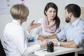 stock photo of insemination  - Marriage couple paying for expensive fertility treatment - JPG