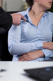 foto of inappropriate  - Vertical view of inappropriate behavior at work - JPG