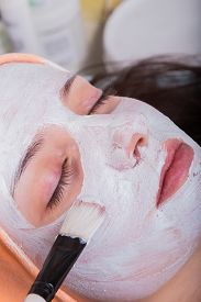picture of face mask  - Young woman at spa procedures applying mask - JPG