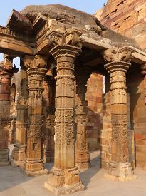 pic of qutub minar  - Columns with stone carving in courtyard of Quwwat - JPG