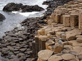 stock photo of unexplained  - Years of tidal erosion and waves have formed these hexagon shape rocks - JPG