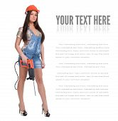 image of hammer drill  - Young sexy female dressed in jeans and orange helmet holding hammer  electric drill - JPG