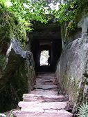 picture of step-up  - stone steps leading through a tunnel carved from solid rock in the grounds of blarney castle ireland - JPG